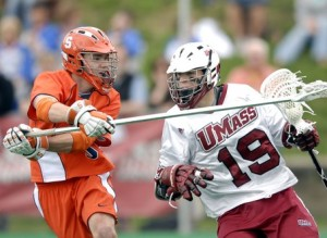 Syracuse defenseman Evan Brady, left, pressures UMass attacker Tim Balise during the first quarter of their lacrosse game at Amherst on Saturday, April 28, 2007. STAFF PHOTO BY CHRISTOPHER EVANS.